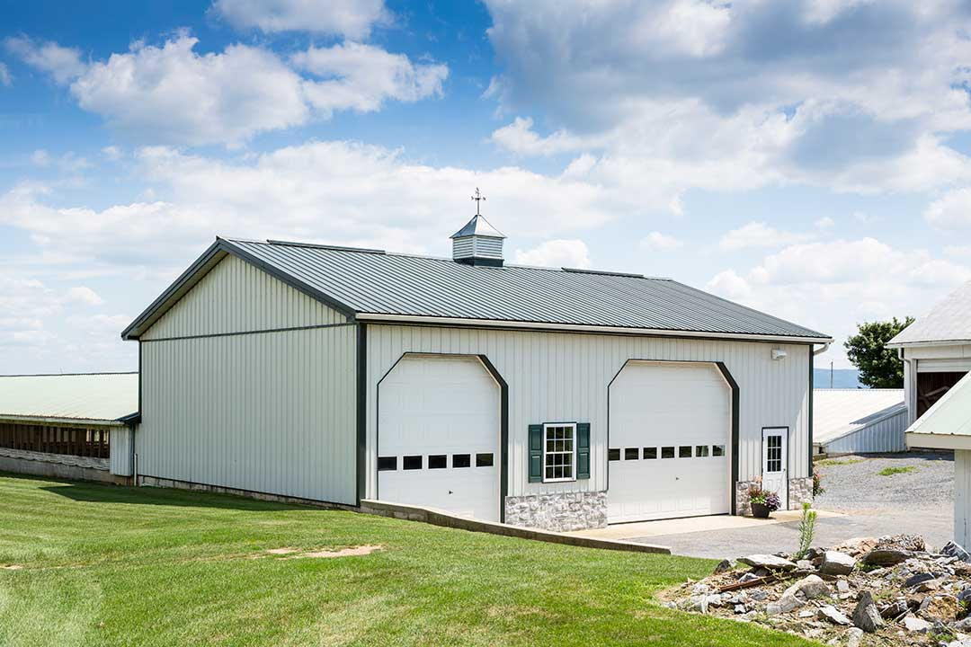 Garage with Standing Seam Metal Roof by Creek View Construction